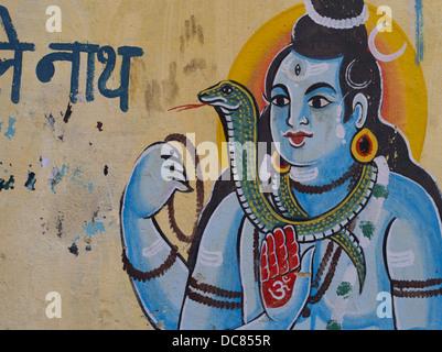 hindu god Shiva Painted mural on the buildings located on the banks of the Ganges River - Varanasi, Uttar Pradesh, - Stock Photo