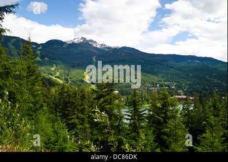 Scenic view of Whistler mountain, forests, and Nita Lake in the summer.  Whistler, British Columbia, Canada. - Stock Photo