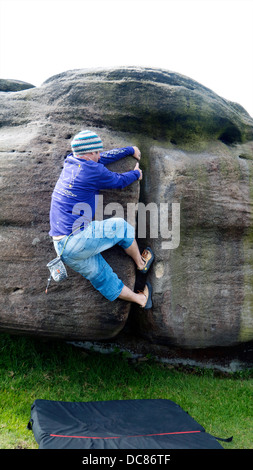 rock climber bouldering at Burbage Edge South, Derbyshire, Peak District National Park, England, UK, United, Kingdom - Stock Photo