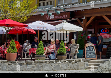 Diners At Outdoor Restaurant In Village Square In French