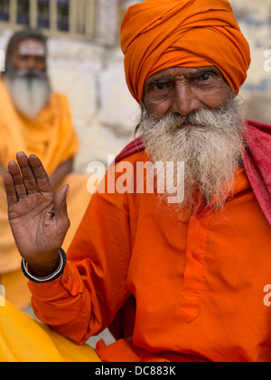 Sadhu holy man on the banks of the Ganges River - Varanasi, India - Stock Photo