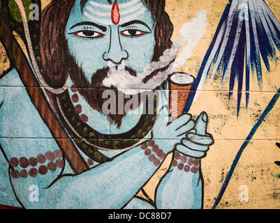 Hindu god shiva smoking Painted mural on the buildings located on the banks of the Ganges River - Varanasi, Uttar - Stock Photo