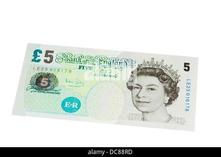 English five pound note on a white background - Stock Photo