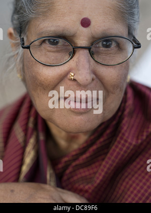 Portrait of pilgrim who had  traveled to the Ganges River ( Varanasi ) for Kumbh Mela in March 2013. - Stock Photo
