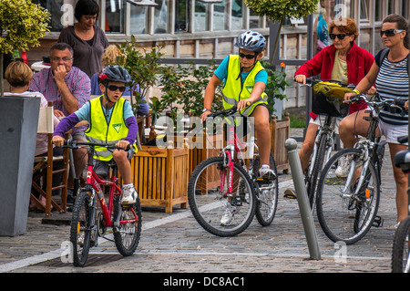 A family on bicycles with other people nearby in Saint-Valery-sur-Somme, a commune in the Somme department, northern - Stock Photo