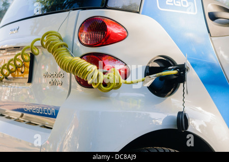 Electric car being recharged - Stock Photo