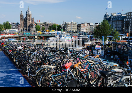 Hundreds of bicycles parked in Amsterdam - Stock Photo