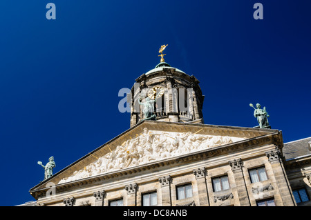 Clock on the top of the Royal Palace in Dam Square, Amsterdam - Stock Photo