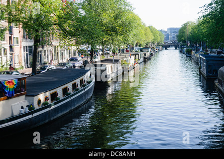 Canal boats in Amsterdam - Stock Photo