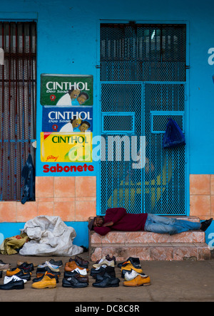 Man Selling Shoes In The Street, Maputo, Mozambique - Stock Photo