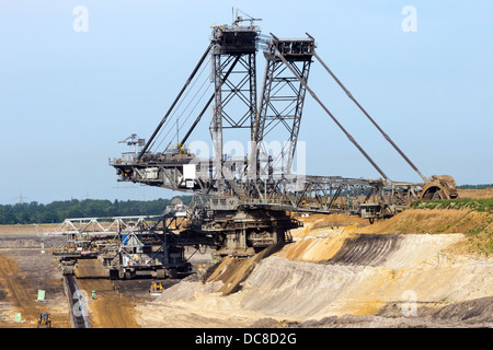 Bucket wheel excavator in a brown coal open pit. - Stock Photo