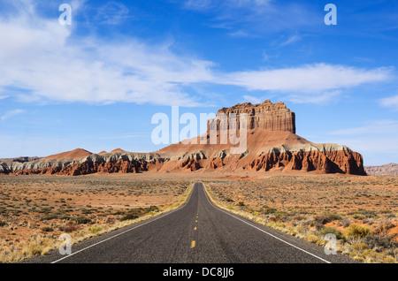 Long road towards Wild Horse Butte near Goblin Valley in Utah, USA - Stock Photo