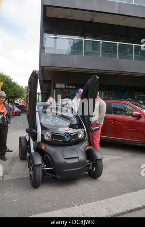 Europe Renault Twizy Electric Car with scissor doors on display on car showroom forecourt - Stock Photo