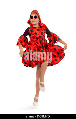 Teen girl dancing in a red polka-dot dress with sunglasses. Isolate on white. - Stock Photo