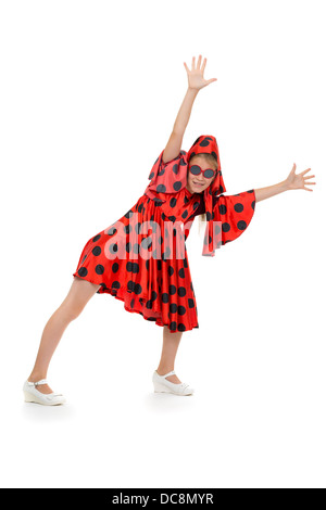 teen girl dancing in a red polka-dot dress with sunglasses. Isolate on white background - Stock Photo