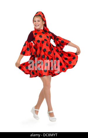Girl dancing in a red polka-dot dress. Isolate on white. - Stock Photo