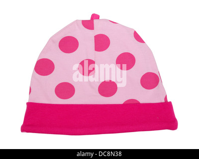 Pink baby hat with polka dots on a white background - Stock Photo