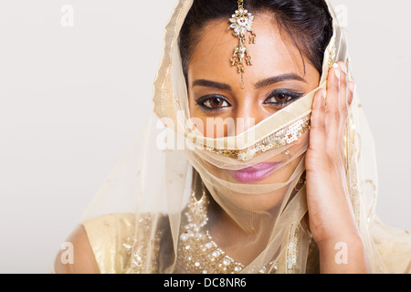 portrait of beautiful Indian woman in sari costume covering her face - Stock Photo