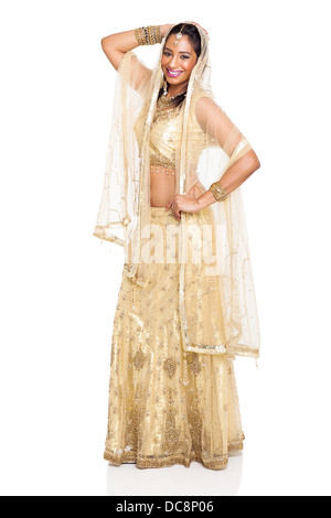 cheerful young Indian woman posing in traditional sari isolated on white background - Stock Photo