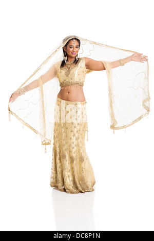 happy young Indian woman in sari dancing on white background - Stock Photo