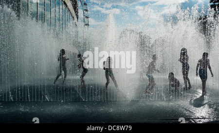 Children playing in 'Appearing Rooms' water fountain by Danish artist Jeppe Hein  Royal Festival Hall London UK - Stock Photo