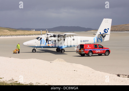 Plane on the beach at Barra Airport in the Outer Hebrides, Scotland -  the only place in the UK with scheduled beach - Stock Photo