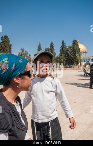Temple Mount, Jerusalem, Israel. An observant Jewish boy and his mother in front of the Golden Dome ('Dome of the - Stock Photo