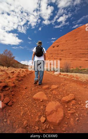 A hiker on the trail of Khata Tjuta; Ayer's Rock, Northern Territory, Australia - Stock Photo