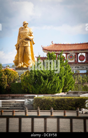 Golden statue of Chinese communist soldier; Dali City, Yunnan, China - Stock Photo