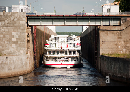 Cruise ship going into a lock on Volga-Baltic Waterway Russia - Stock Photo