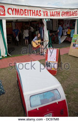 A performer outside the Welsh Language Society (Cymdeithas yr Iaith Gymraeg)  stand at the 2013 National Eisteddfod - Stock Photo