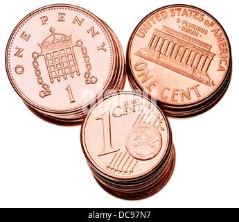 British pennies; American 1c pieces; Euro 1c pieces. - Stock Photo
