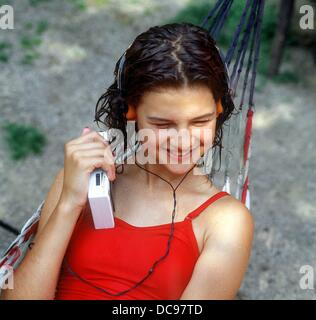 A young girl listens to music with her walkman (picture taken in 1986). - Stock Photo