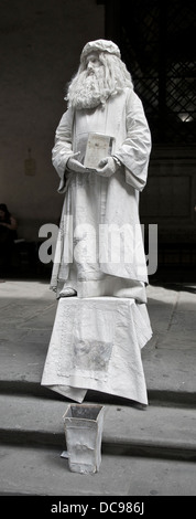 Statue of Leonardo da Vinci ...by himself ? In front of the Uffizi Gallery in Florence, Italy. - Stock Photo