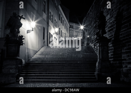 mysterious narrow staircase with lanterns in Prague at night - Stock Photo