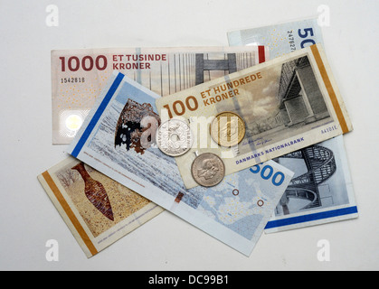 Danish krone, coins on banknotes - Stock Photo