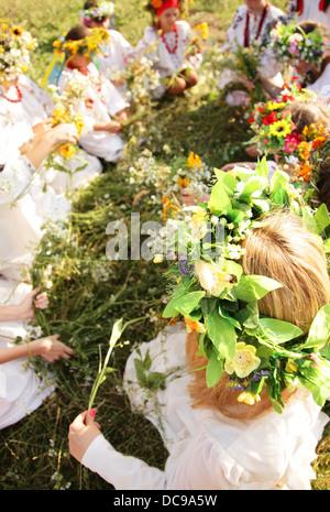 Young girls in ukrainian traditional national costumes, Ivan Kupala Day celebration, Kiev, Pirogovo, Pyrohiv, Ukraine - Stock Photo
