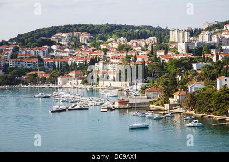 A yacht basin by luxury condos on the coast of Croatia - Stock Photo