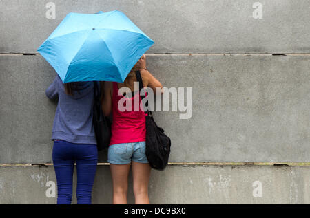 Berlin, Germany. 13th Aug, 2013. Tourists from Switzerland visit the memorial site Berlin Wall in Berlin, Germany, - Stock Photo