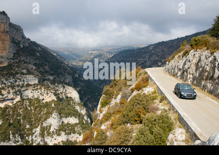 A car makes its way around winding roads in Provence, France - Stock Photo