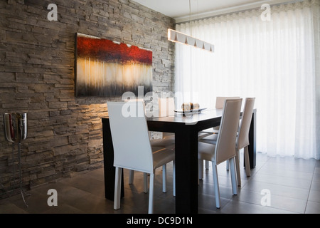 Dining room inside a modern residential home - Stock Photo