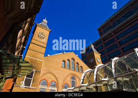 Liverpool street railway station old brick structure glowing in the early morning sun, City of London - Stock Photo