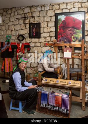 Ethnic hill tribe ladies weaving at the Victoria Sapa Resort in Sapa, Vietnam, Asia. - Stock Photo