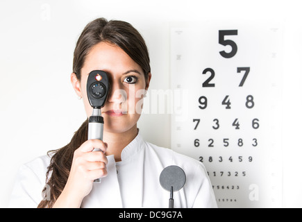 Young eye doctor W25 with ophthalmoscope - Stock Photo