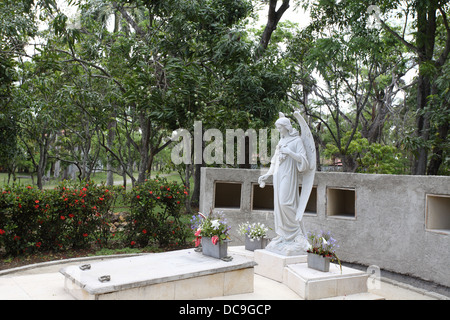 Fidel Castro's parents grave in the grounds of the family estate in Biran. - Stock Photo