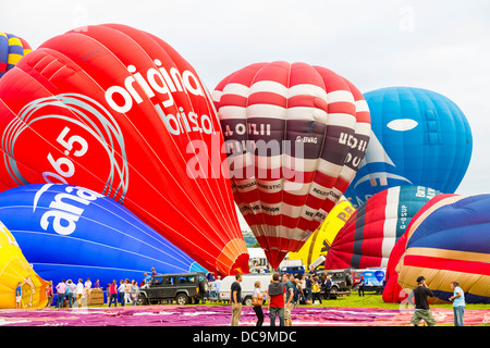 Bristol, UK, 10th August 2013, A selection of balloons inflate and prepare for lift off at the 35th Bristol balloon Fiesta