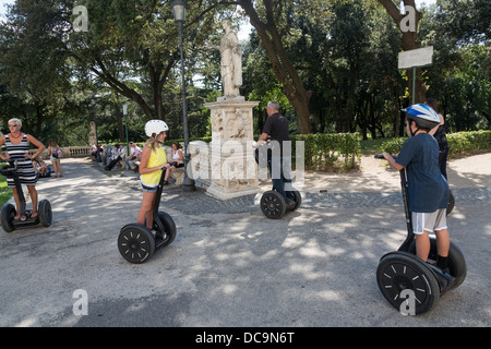 tourists sightseeing on Segway personal transporters, Villa Borghese park, Rome, Italy - Stock Photo