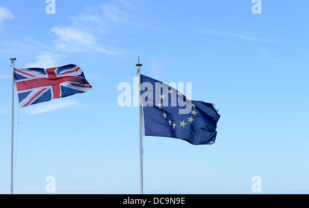 Union Jack and European Union flags flying together - Stock Photo