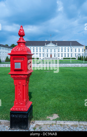 Historic red firebox in front of the Bellevue Palace, Schloss Bellevue, residence of the President of Germany, Berlin - Stock Photo