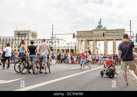 Many people on the 17th of June Street and Square and Brandenburg Gate, participating in a public event – Berlin - Stock Photo